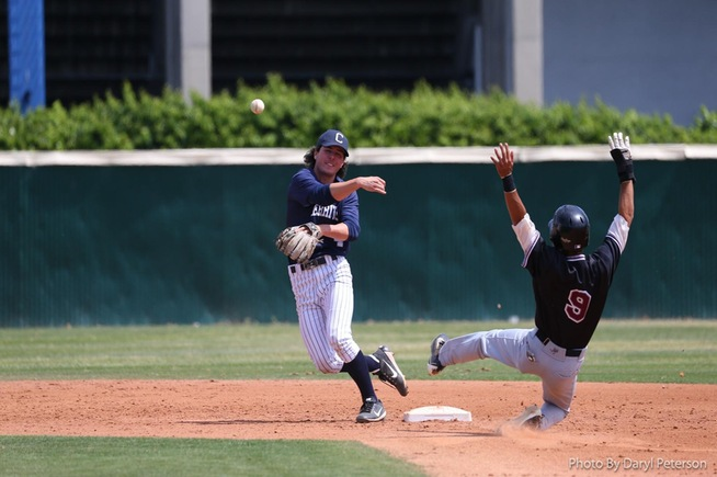 Second baseman Trevor McInerney turns a double play against Compton