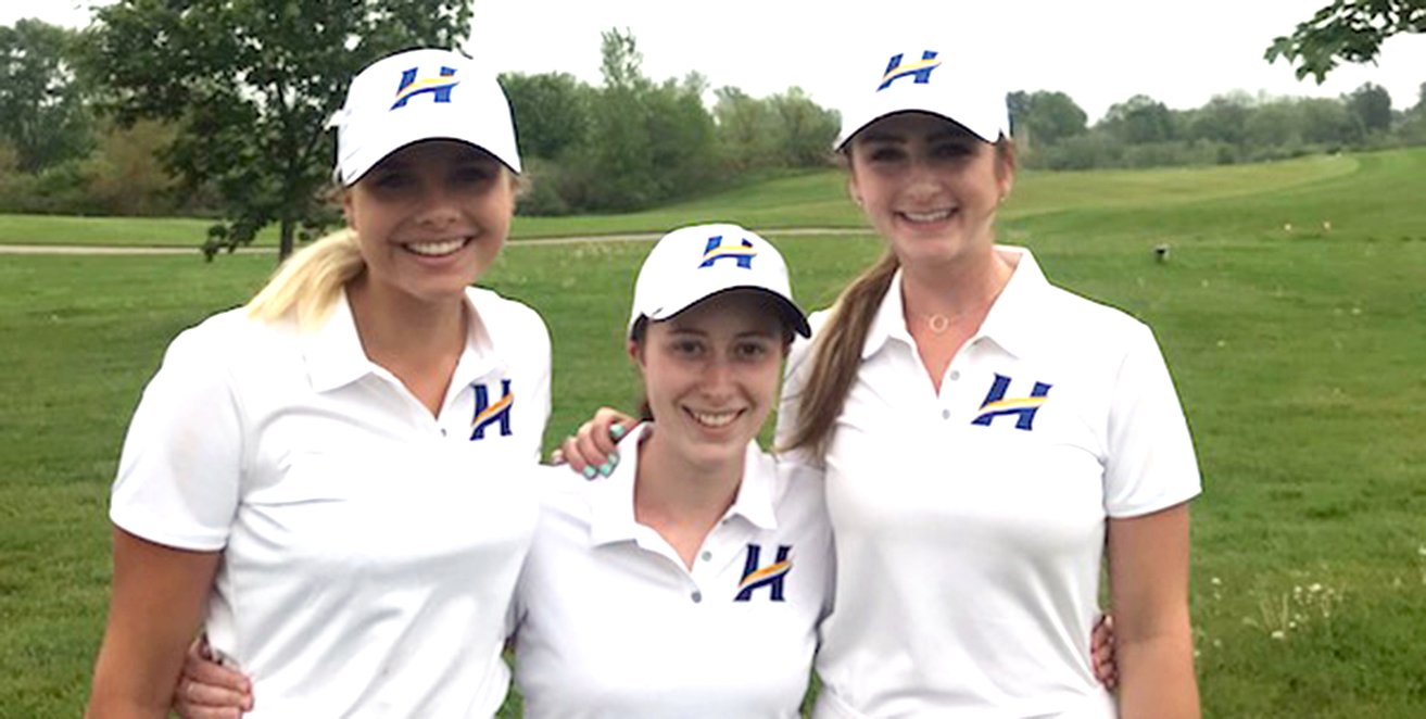Samantha Copeland (middle) is flanked by Rebecca Reitsma on the left and McKenna Lesiuk on the right.