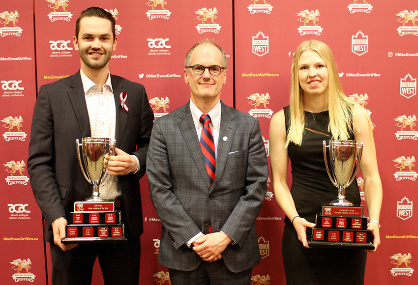 Men's hockey goaltender Marc-Olivier Daigle, left, and women's soccer player Jamie Erickson, right, flank MacEwan University Provost and Vice-President Dr. Craig Monk after receiving their awards on Thursday night (Jefferson Hagen photo).