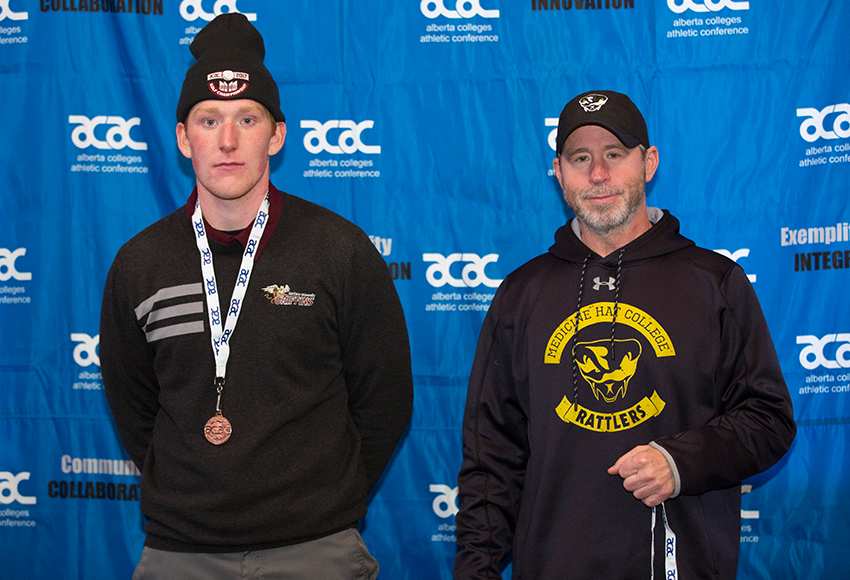 Noah Lubberding, left, accepts the ACAC men's golf bronze medal from representative Terry Ballard on Sunday (RDC Athletics photo).