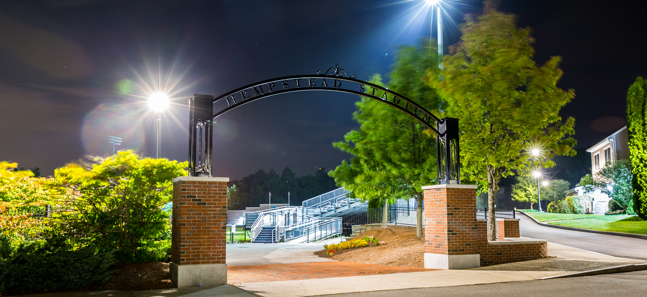 Image of the Hempstead Stadium entry way Arch at night.