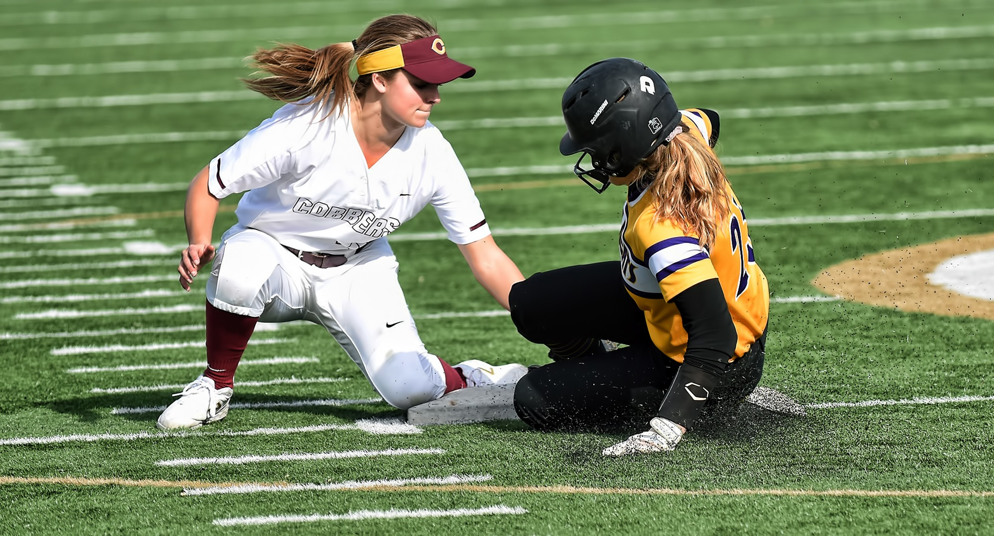 Freshman shortstop Maria Pake plants the tag on a would-be St. Catherine base stealer during the second game of the Cobbers' DH with the Wildcats.