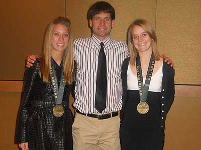 Junior Anna Rudd, head coach Steve Picucci and senior Tina Muir are pictured (left to right)