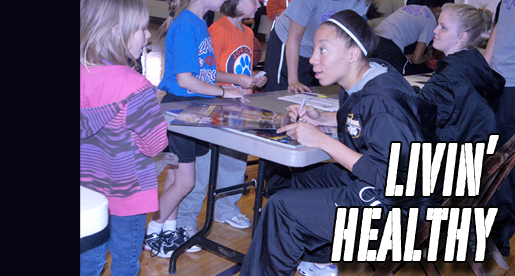 Golden Eagle women's basketball team takes part in YMCA Healthy Kids Day