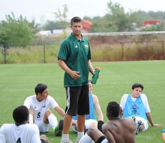 Erik Kotynski (standing) will guide the Felician men's soccer team for the remainder of 2014. (Dave Schofield)