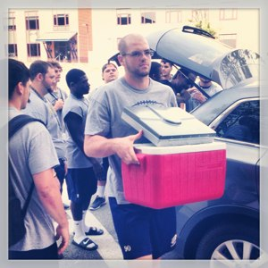 Adham Talaat helps out on 2013 move-in day