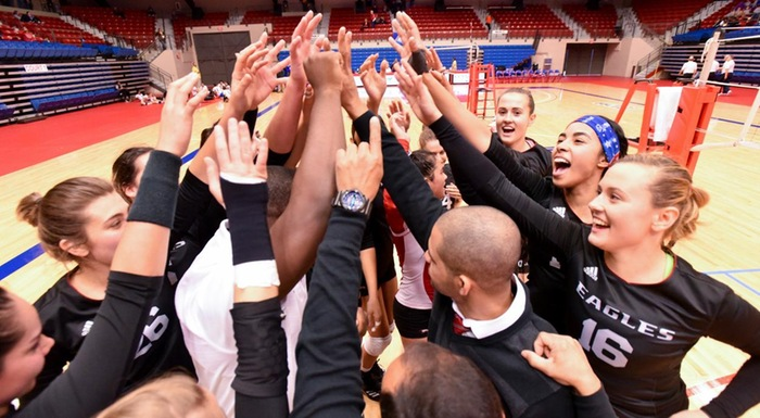 Eagles players and coaches celebrate after defeating Panola College 3-0 in NJCAA Division 1 Women's Volleyball Championship. (Photo by Tom Hagerty, Polk State.)