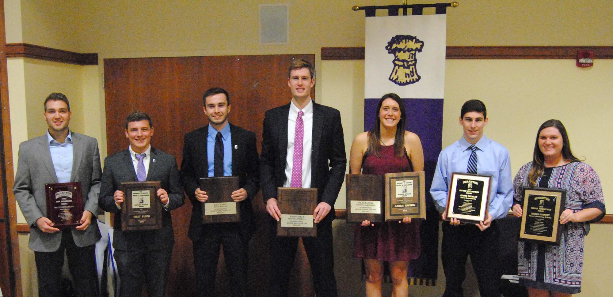 The special award winners at the 2017 Senior Student-Athlete luncheon are, from left, Matt Prendergast of men's tennis (Willensky Award), Matthew Busch of men's soccer (Carlesimo Award), Eric Hintz of men's soccer (O'Hara Award), John Vitkus of men's basketball (O'Hara Award), Sarah Payonk of women's basketball (O'Hara and Carlesimo awards), Jimmy Buckley of men's cross country (Fitzpatrick Award) and Jessica Schmidt of women's swimming & diving (Fitzpatrick Award).
