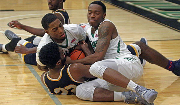 Copyright 2016; Wilmington University. All rights reserved. Photo of Tajee Almon and Brian Adkins going all out for a loose ball, taken by Frank Stallworth.