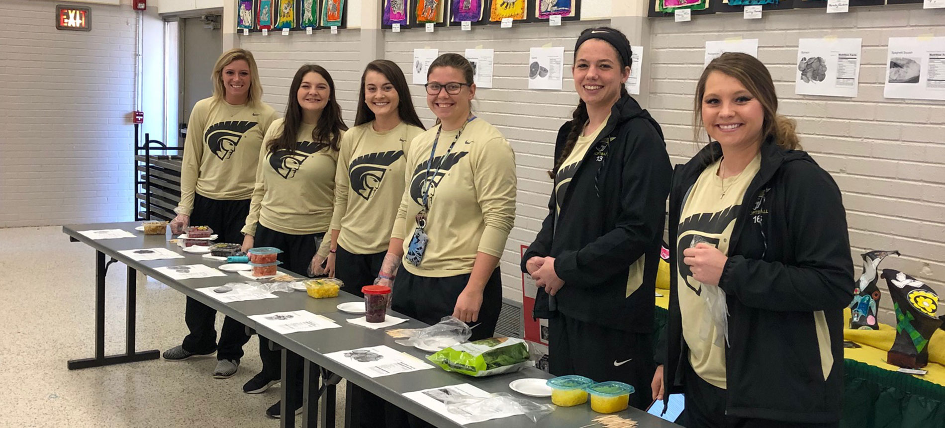 Softball Participates in Nutrition Day at St. Joseph Catholic School