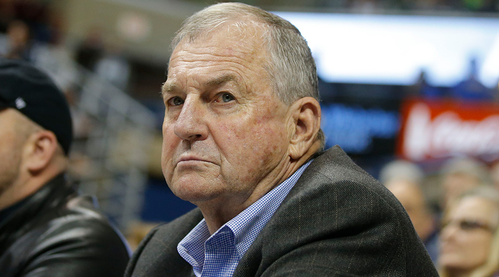Jim Calhoun sitting on the sidelines in a coat without a tie, in a 2014 USA TODAY Sports Images photo by David Butler II