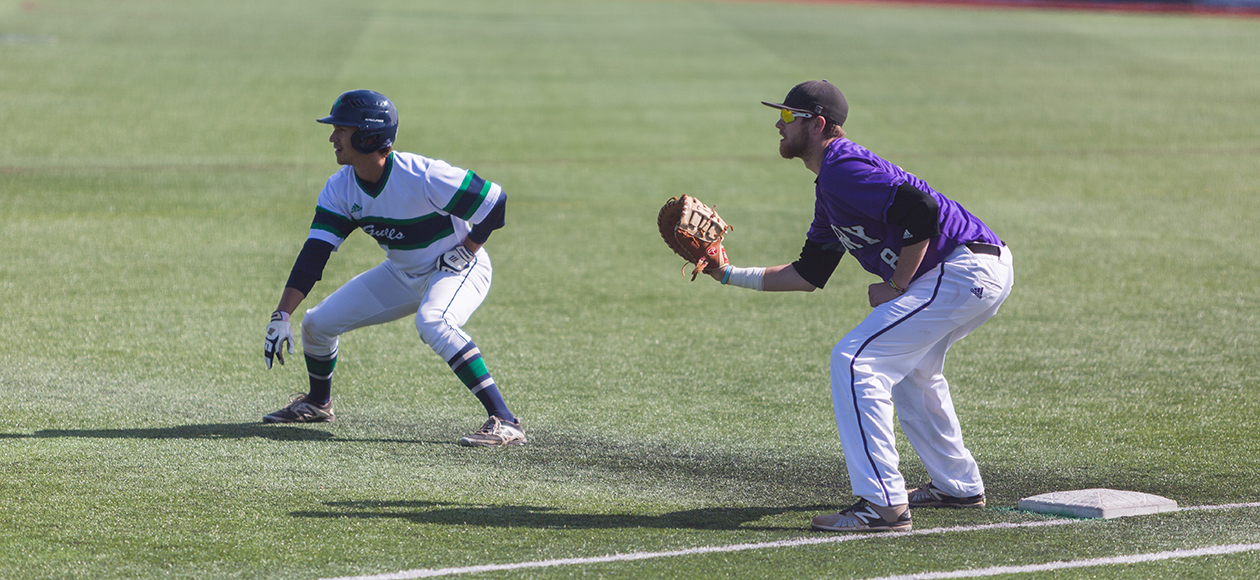 Nick Berno takes a lead at first base against Curry.
