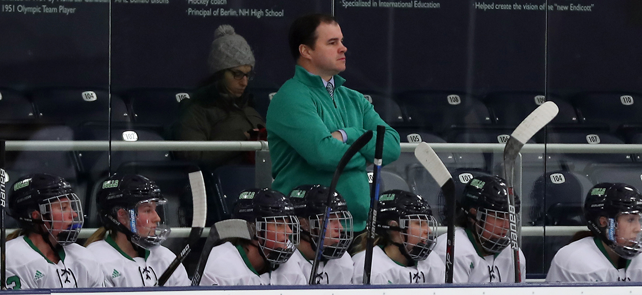 Head coach Andrew McPhee on the bench during a game.