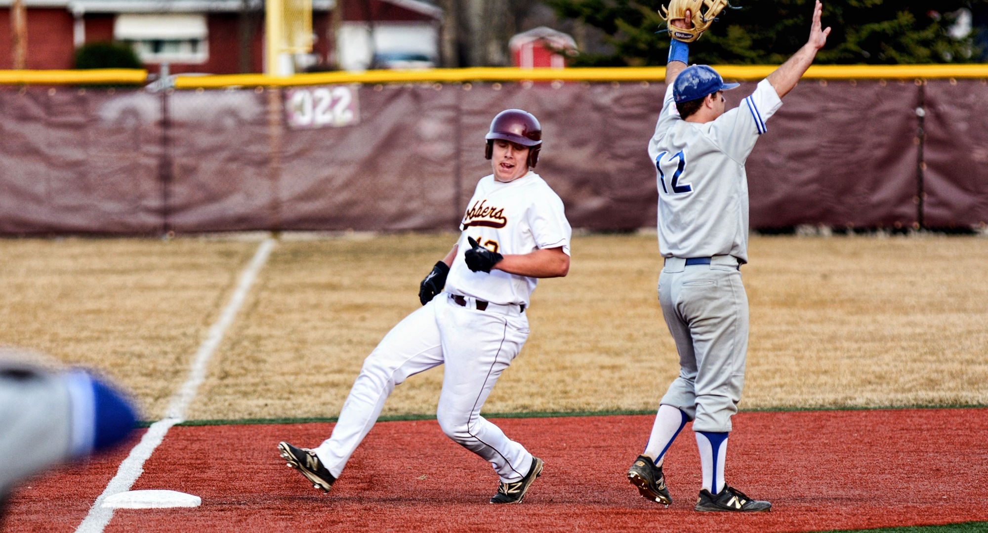 Junior Nate Leintz glides into third base in the 10th inning of the Cobbers' home opener against Mayville State.