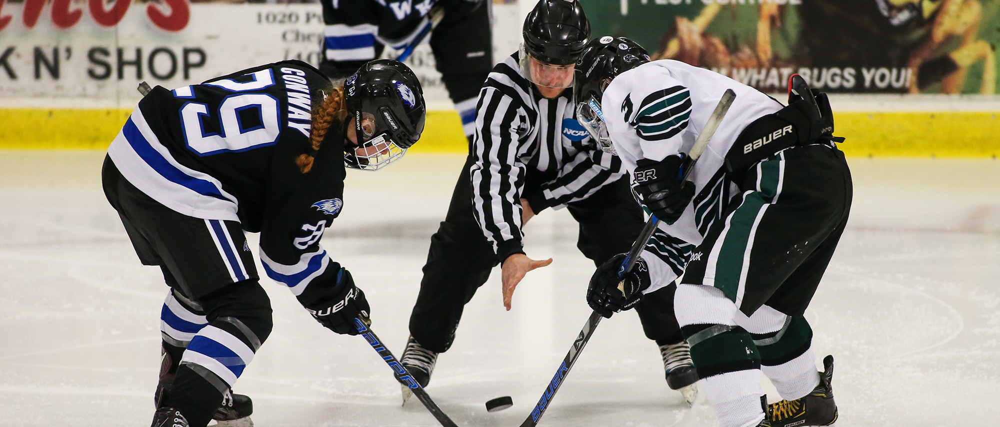 Clare Conway in a faceoff, women's ice hockey at Nichols