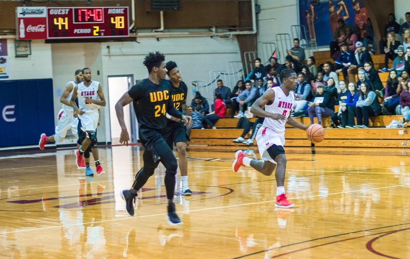 Men's Basketball Moves Past Post Eagles In Close Division Battle