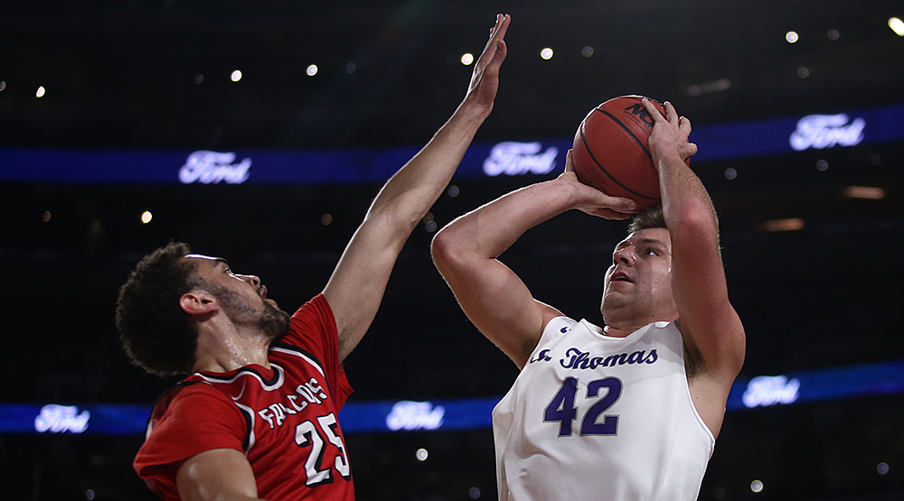 St. Thomas forward Connor Bair shoots over UW-River Falls forward Austin Jackson in the first half of the teams' contest at U.S. Bank Stadium in Minneapolis. (Photo by Ryan Coleman, d3photography.com)
