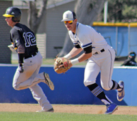 Barton Baseball's Dawson Pomeroy fields and sets to throw
