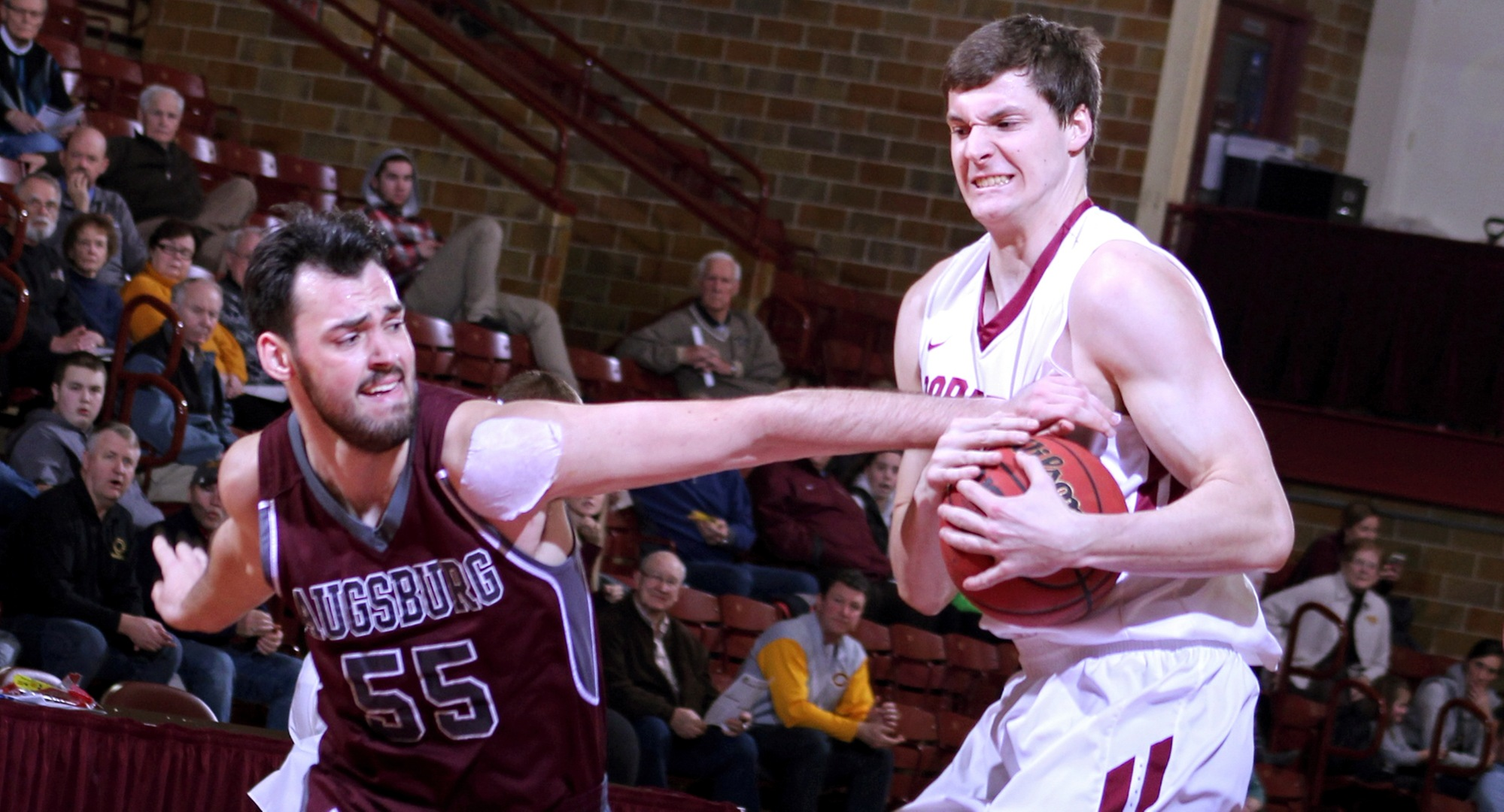 Junior Kevin Wolfe grabs a rebound away from an Augsburg player during the Cobbers' win over Auggies. Wolfe finished with seven points.