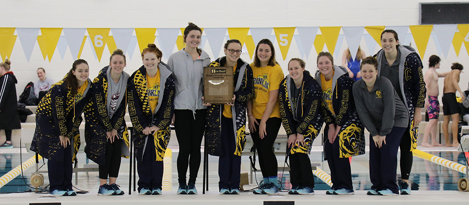 The FC women holding the conference championship plaque (Photo courtesy of Sara Landis, HCAC)