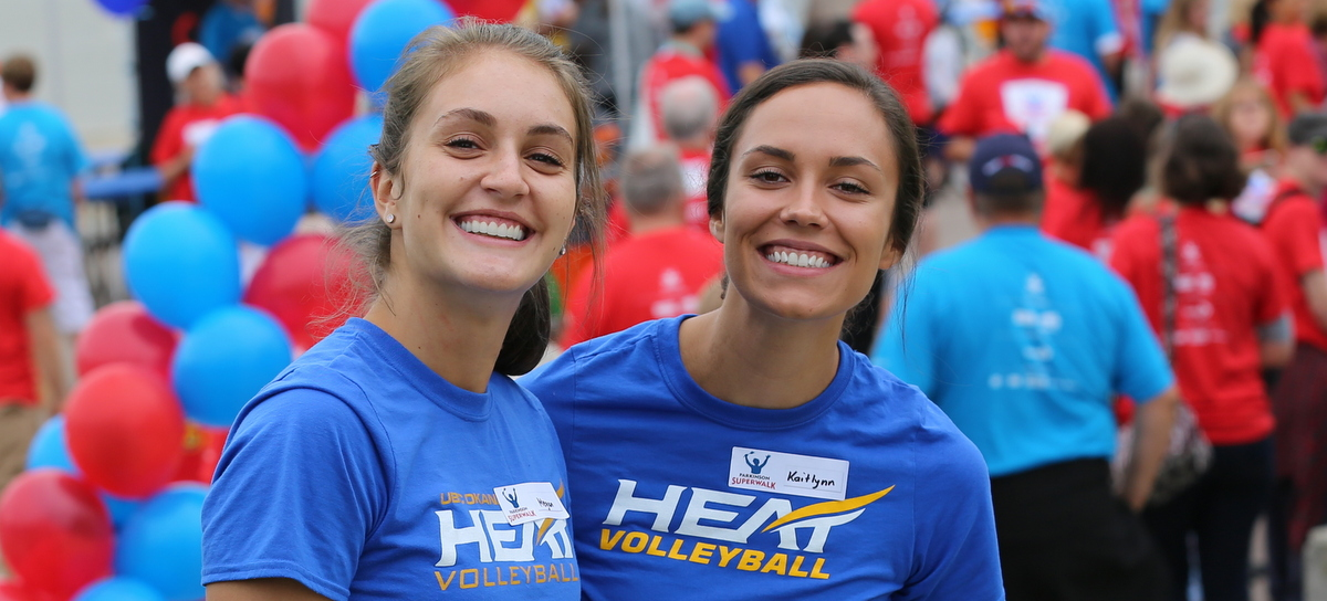 Pictured here are Megan Festival and Kaitlynn Given, two women's volleyball players volunteering at the annual Parkinson Super Walk Fundaraiser - September 2016.