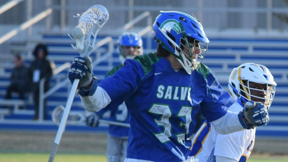 Salve Regina scored the last four goals of the game to break an 11-11 tie and defeat Saint Joseph's of Long Island (Photo by Ed Habershaw).