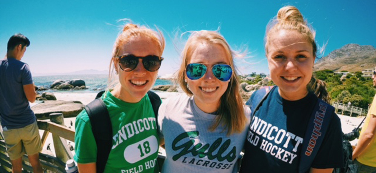 Field hockey players Ashleigh Allen, Brittany Bushey, and Erin McCarthy in South Africa.