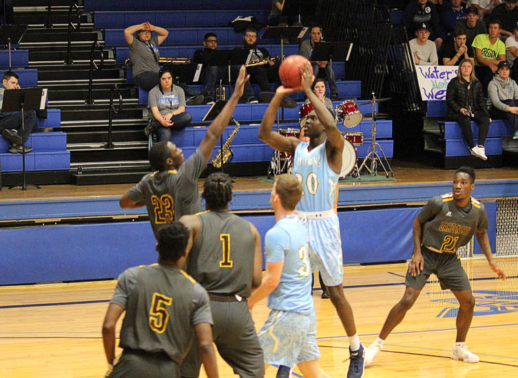 CCC sophomore Gabe Gyamfi knocks down two of his 20 points Jan. 10 against Garden City at the Colby Community Building. The Trojans won the contest 82-71.