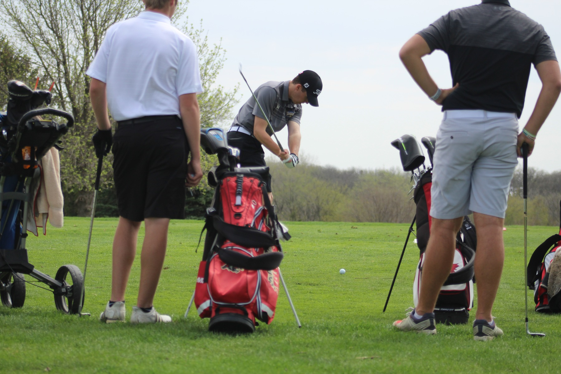 NIACC's Josh Schaefer tees off on a par three in first round of regional golf tournament Saturday in Panora.