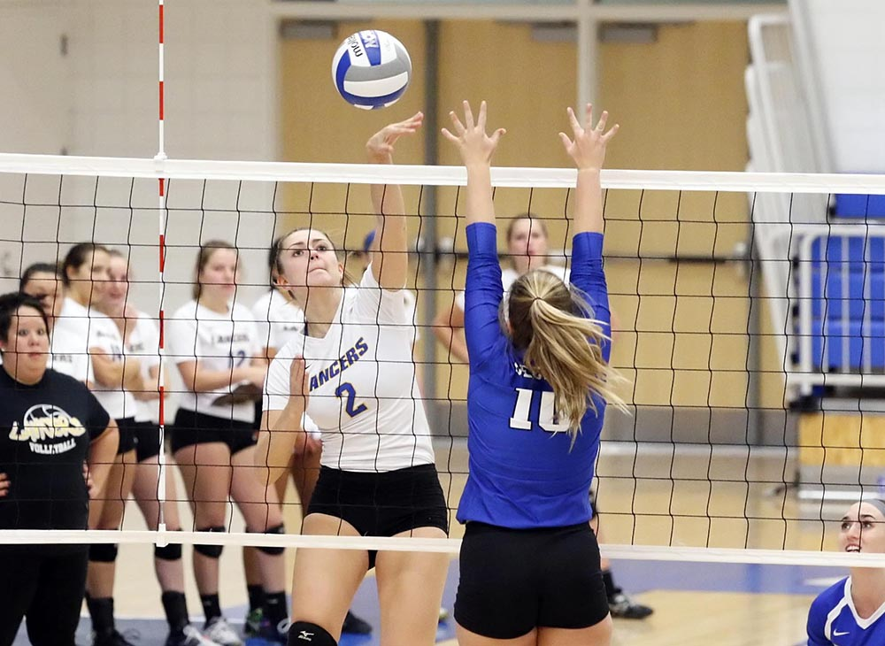 Volleyball Sweeps Lasell in Home Opener