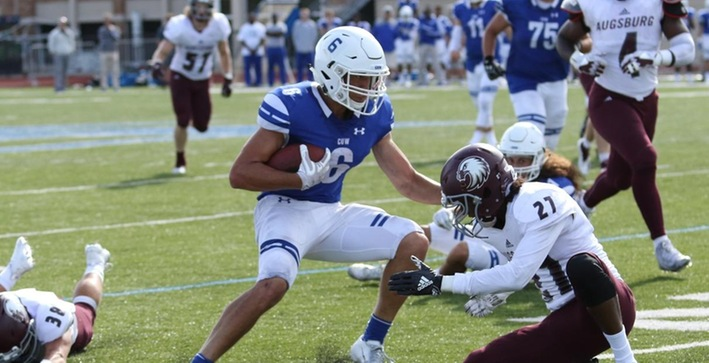 Football scores three TDs in fourth during home opener