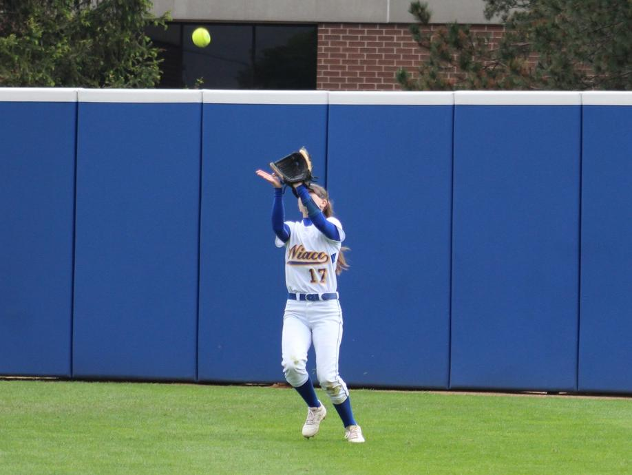 NIACC center fielder Kaitlyn Carlson catches a fly ball in Sunday's second game.