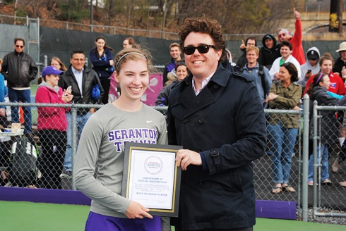 Sophomore Emily Walsh (left) accepts the MVP award from Landmark Conference commissioner Dan Fisher today after leading the Royals to a 5-3 victory over Catholic University in the championship match of the Landmark Conference tournament.  Scranton won its third consecutive title Sunday afternoon at the Royal Courts.