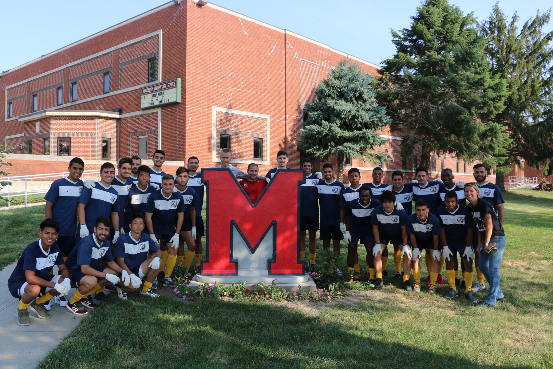 Men's Soccer Helps with Local Clean Up