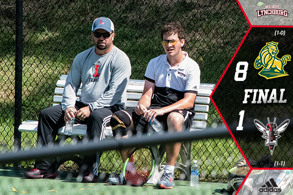 Coach Chris Johnson and Zack Shane sit on a bench between tennis sets.
