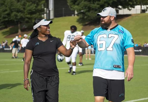 Hassell with 12 year veteran center and five-time Pro Bowler Ryan Kalil. Photo courtesy of the Carolina Panthers