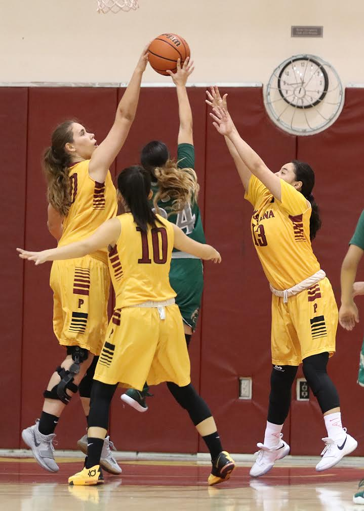 Alisa Shinn (left), Jade Lin (10), and Jacquelyn Luna (right) defend a shot attempt in a recent game. The Lancers host a regional playoff game v. San Diego City College this Wednesday, photo by RIchard Quinton.