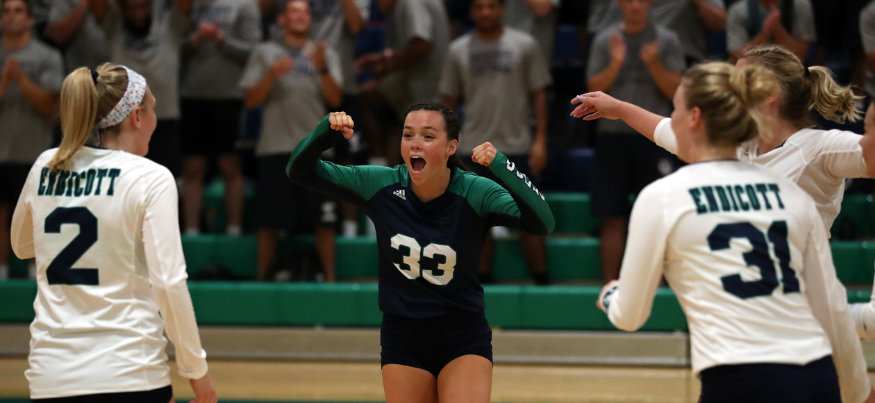 Image of Mackenzie Kennedy celebrating a point with her team.