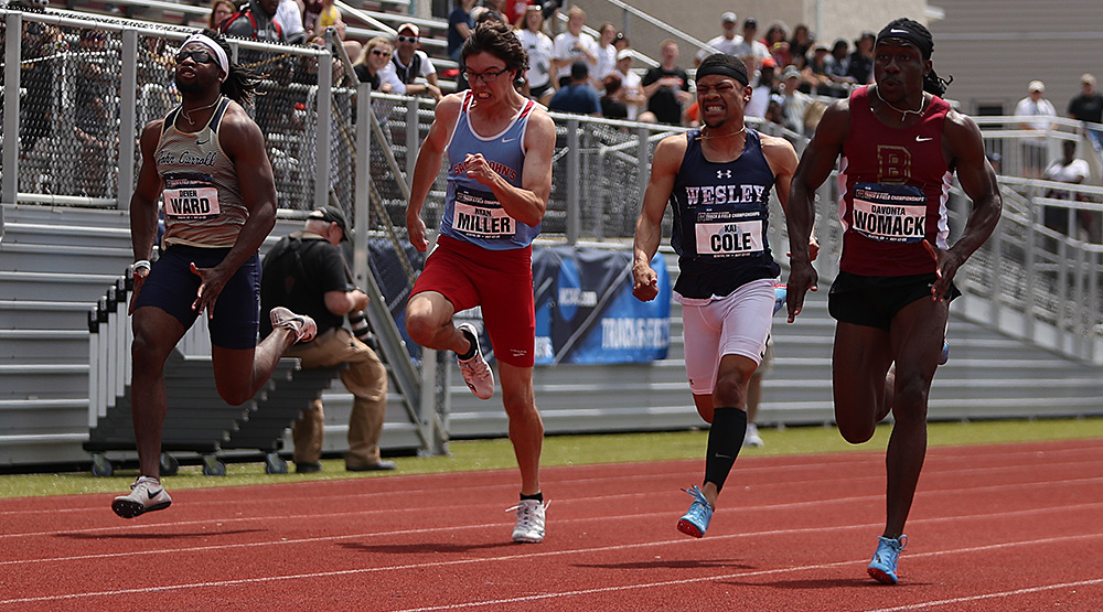 Devonta Womack, right, takes the lead in the 100-meter finals