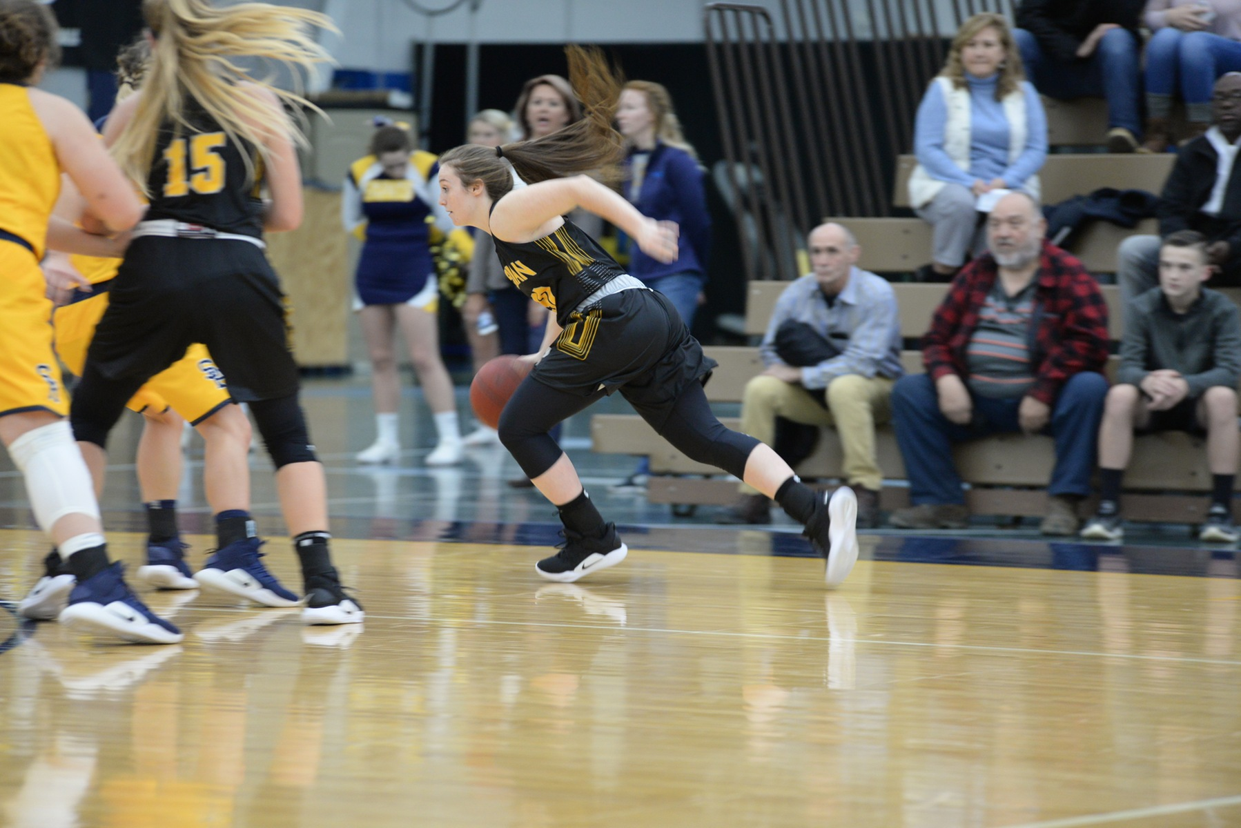 Freshman Rylee Campbell drives the baseline. (Action photo by Patrick Stewart)