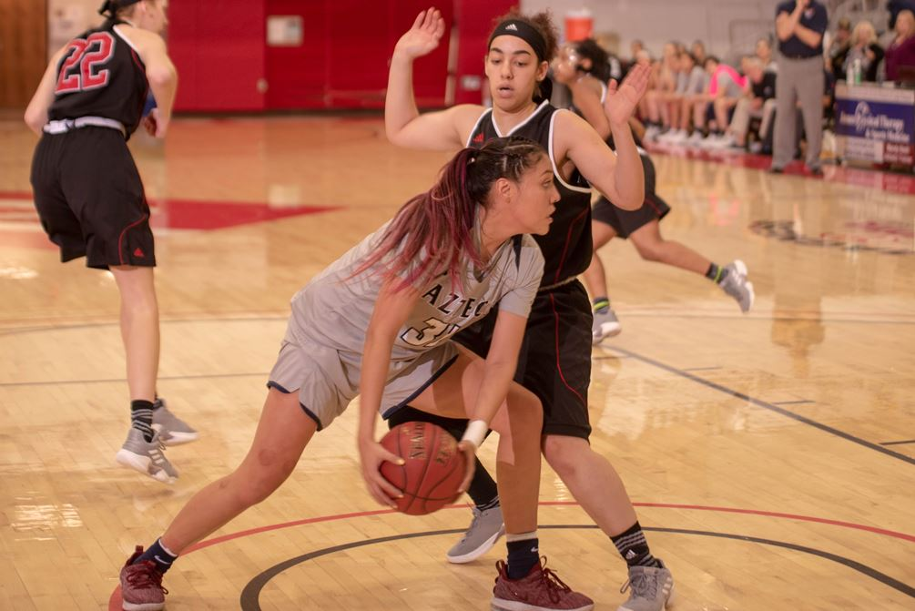 Sophomore Shauna Bribiescas (Dobson HS) scored 12 of her 16 points in the fourth quarter as the Aztecs rallied to beat Lake Michigan College 81-79 in the opening round of the NJCAA Division II Tournament. Bribiescas had her 12th double-double as she also grabbed 11 rebounds. The Aztecs play Kansas City Kansas Community College on Wednesday at 6:00 p.m. (CT); 4:00 p.m. (MST). Photo by Brandon Cone/North Arkansas College