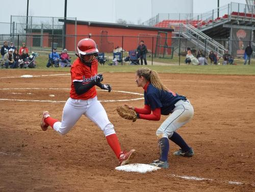 Cardinals Collect Two Wins in Conference Tournament Opening Day