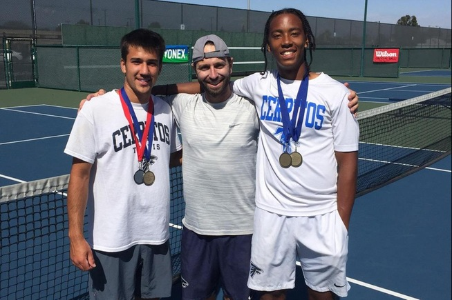 (L-R) Victor Castro, head coach Quinn Caldaron and Kent Hunter celebrate after the pair won the conference doubles championship