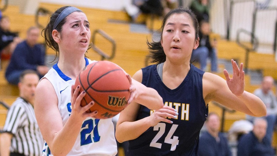Sam Gisonni scores two of her team-high 11 points on a drive to the basket. (Photo by Rob McGuinness)