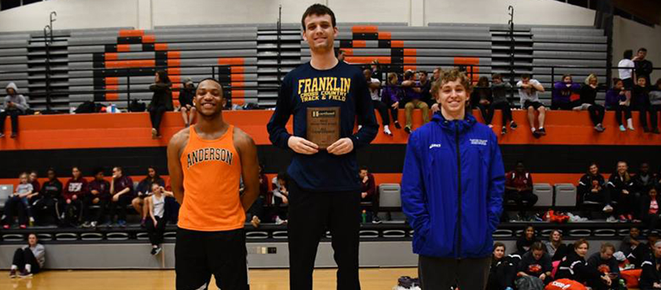 Matt Stienke (middle) on the podium after his win in the 60 meter hurdles (Photo courtesy of Anderson University)