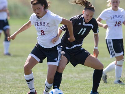 Lauren Fortuna (#8) battles for possession of the ball in Sunday's match at Grand Valley State.