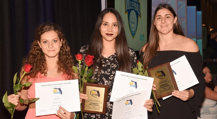 Chiara Bosetti, Kathya Garcia, and Anilise Fitzi display awards they received at state volleyball tournament. (Photo by Tom Hagerty, Polk State.)