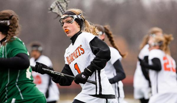 Holly Cooperrider playing lacrosse.