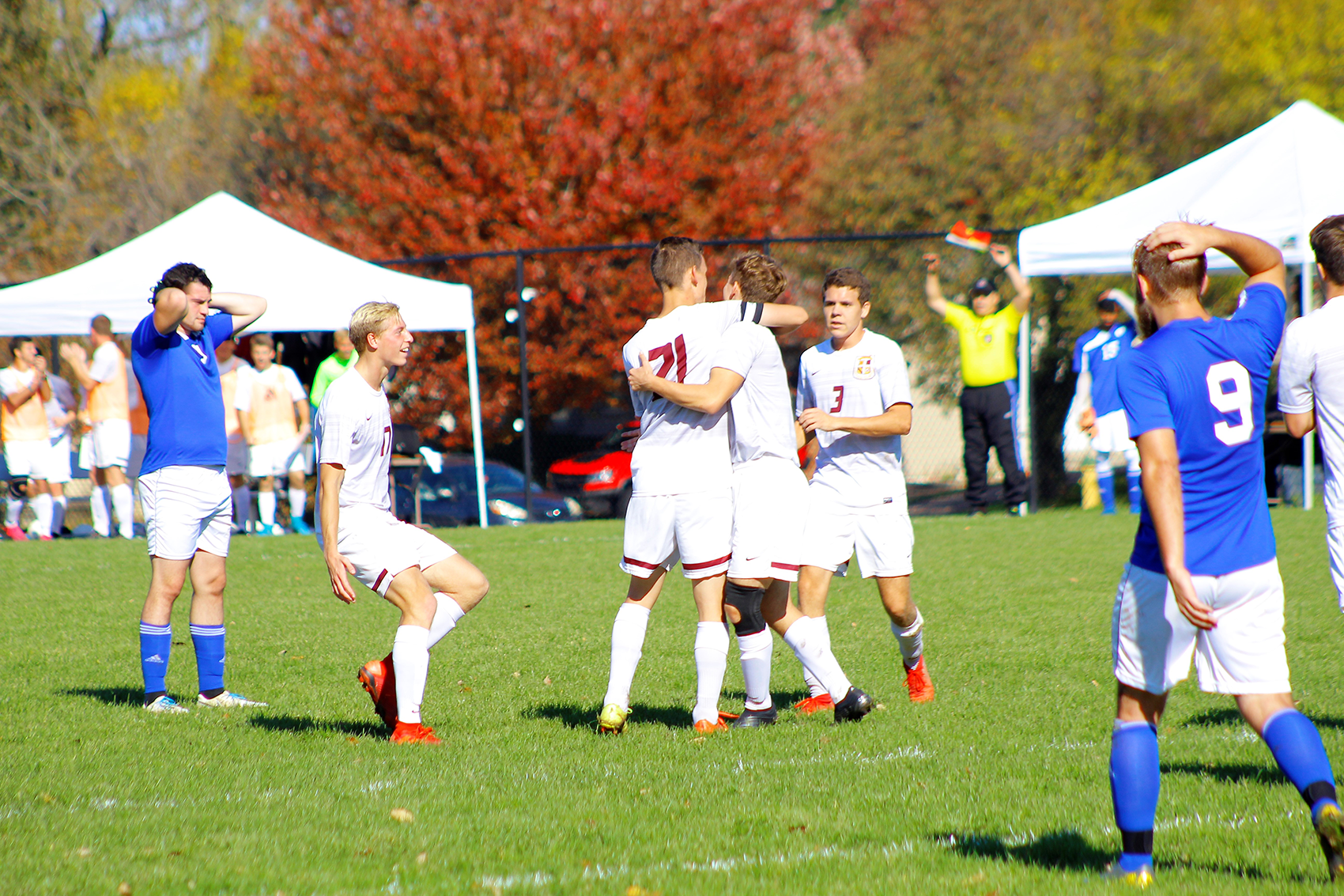 Eagles players congratulate Isaac Mosher after his goal gave Faith a 1-0 lead.
