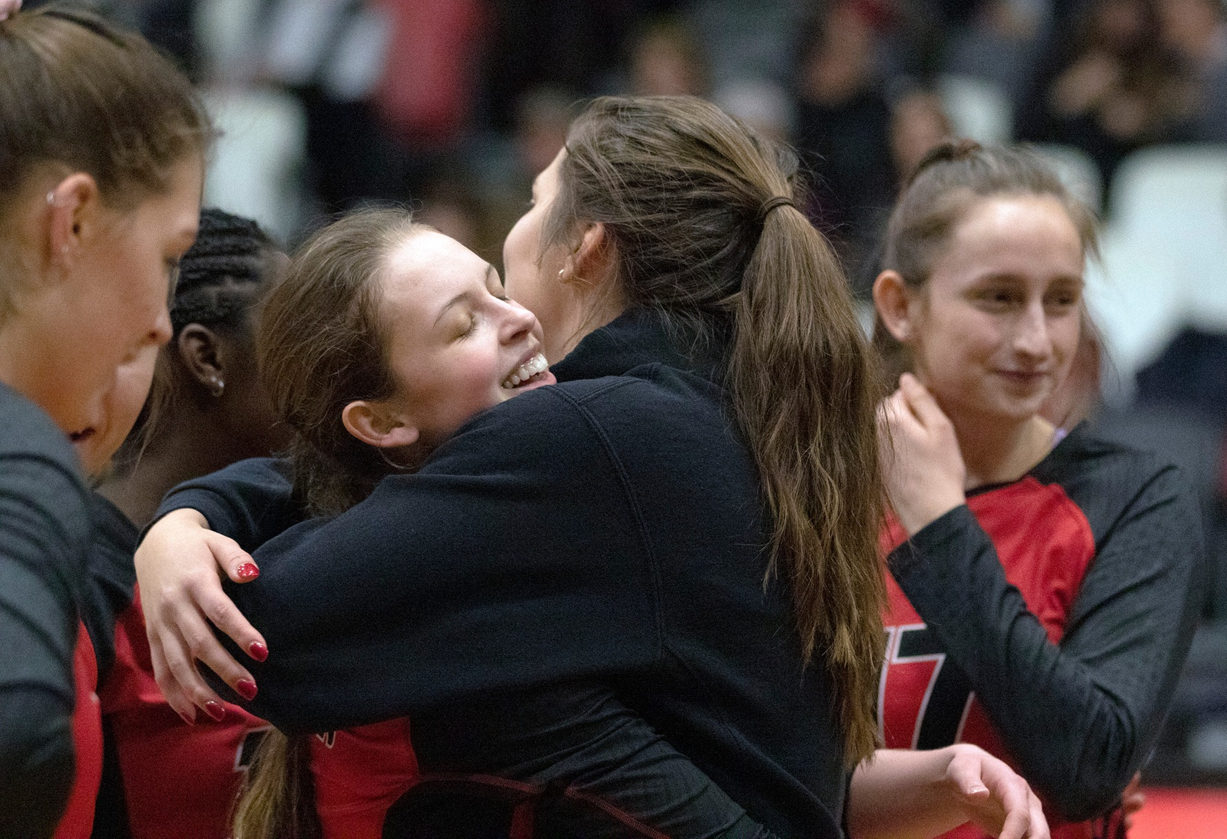 Setter Rylie Dickson celebrates with teammate Taylor Boughton immediately after the Wesmen women's volleyball team captured the 53rd annual Wesmen Classic on Monday, Dec. 30, 2019. (David Larkins/Wesmen Classic)